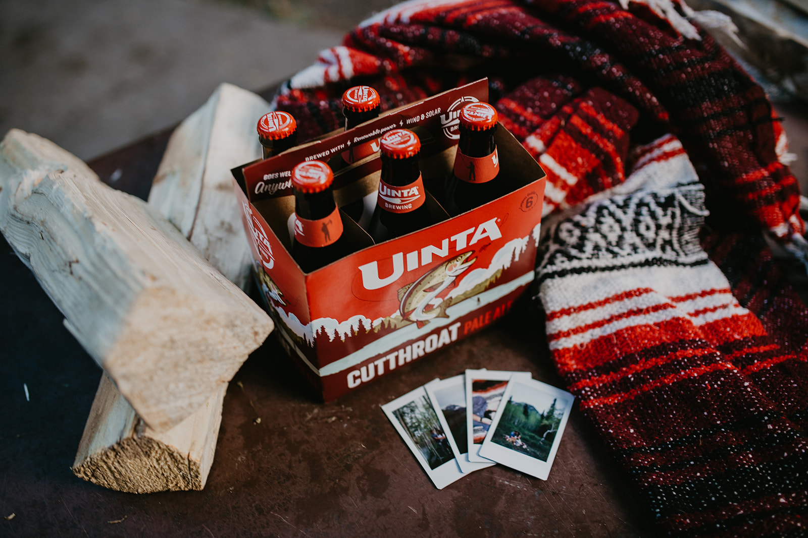 Drinking beer around a camp fire with a couple after their session in Utah