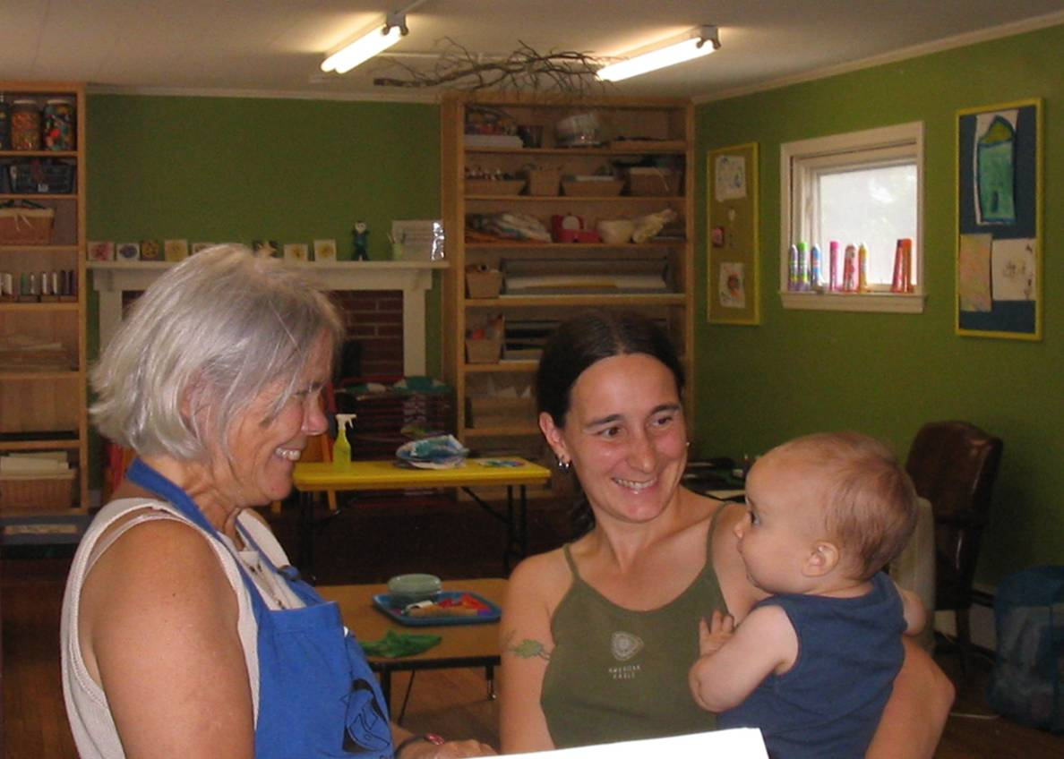 Playhouse Visitor Services Manager Kay Philipp admires Kristi Frederberg's baby.jpg