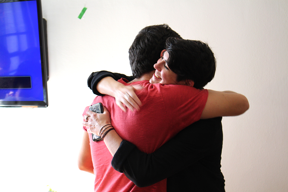 Leyla shares a congratulatory hug with Murillo, one of the fellows on the winning team