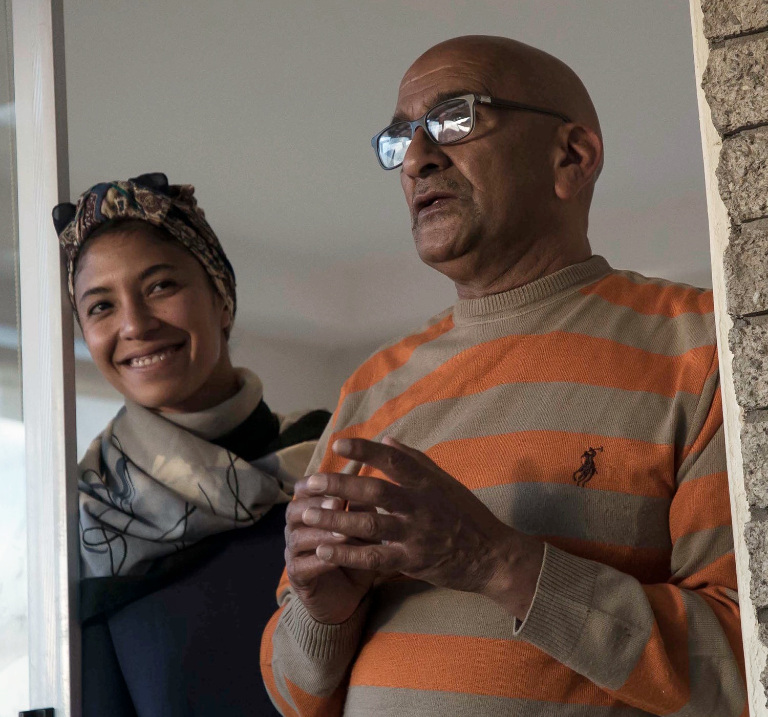 Zaayan and her father greeting us into their home