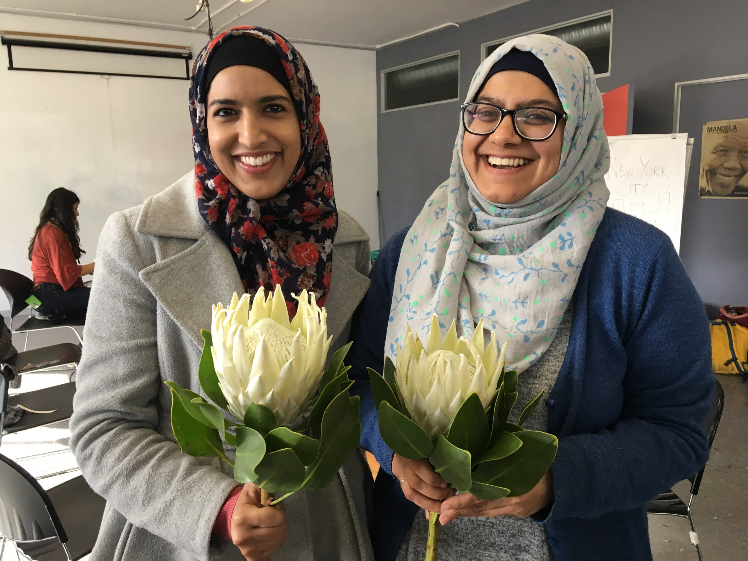 Kausar and Saleemah celebrating the wrap up of the fellowship with South Africa's national flower, the impressive Protea