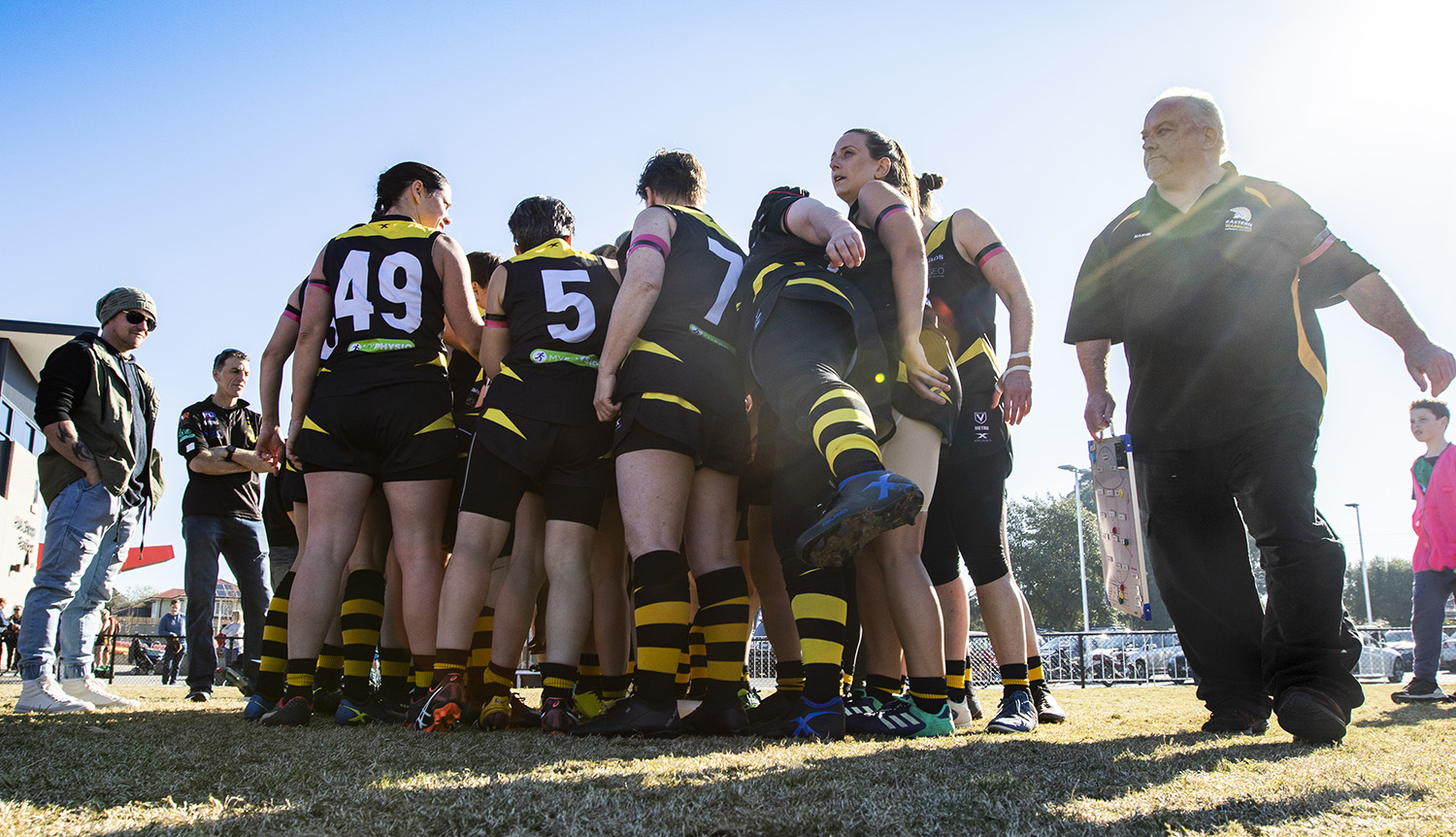 Final huddle at the last game of the season. Throughout the year the women developed strong bonds and Nash says they often resolved issues within the team without his input.