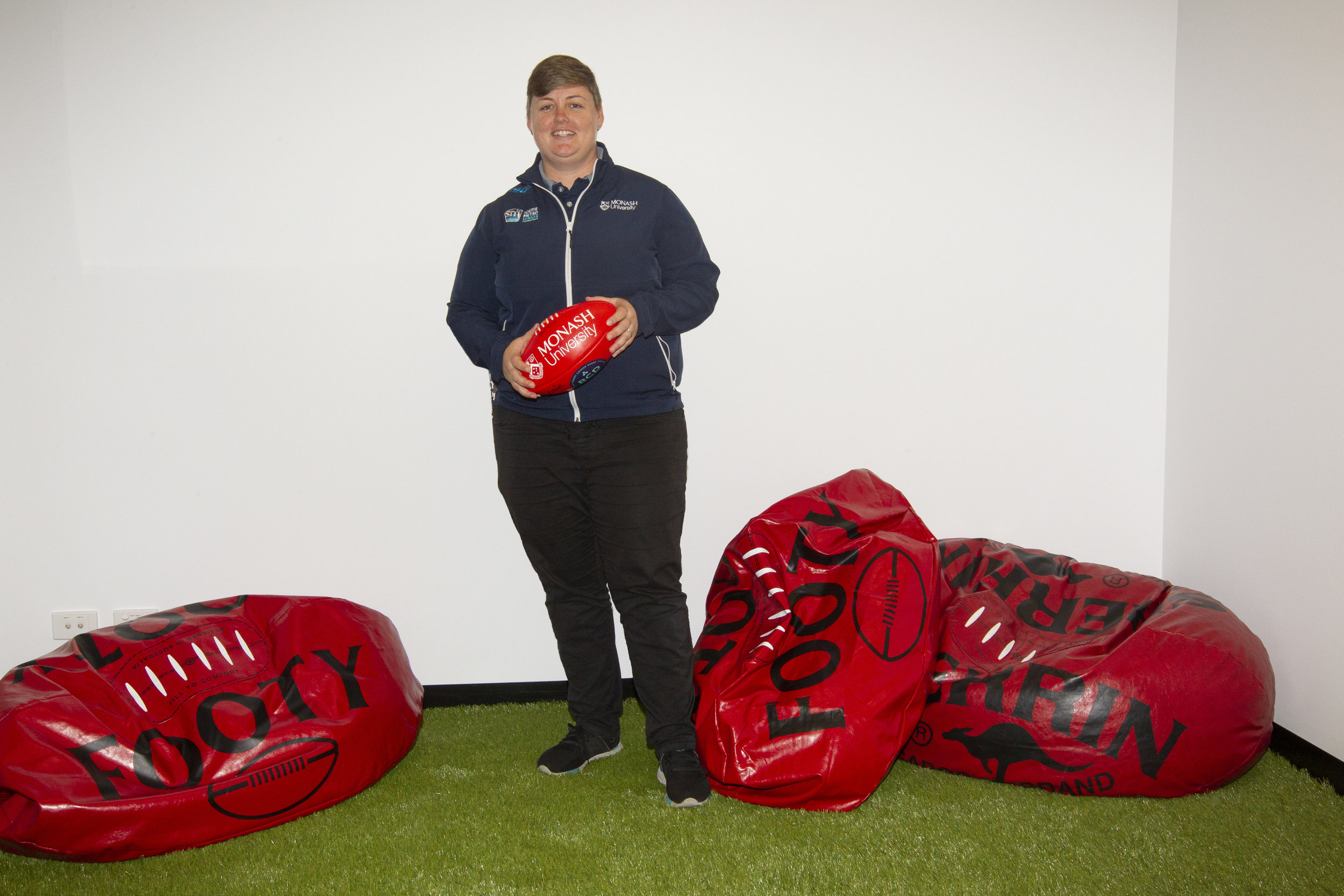 The finest of football furnishings! A rec room at the new facility features football beanbags!