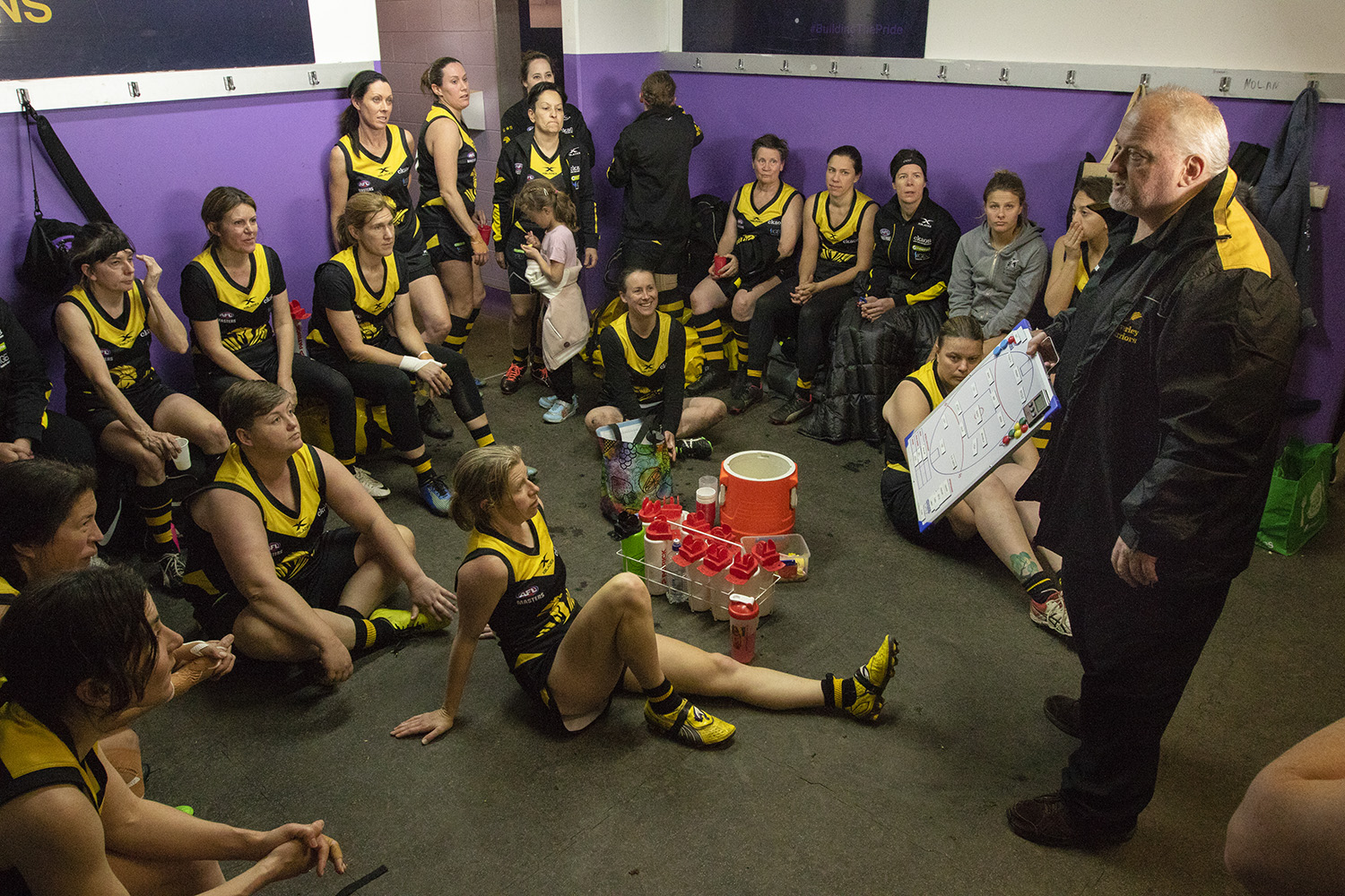 Pre-game instructions from coach Peter Nash. Beventyre (sitting at left) absorbs the message.