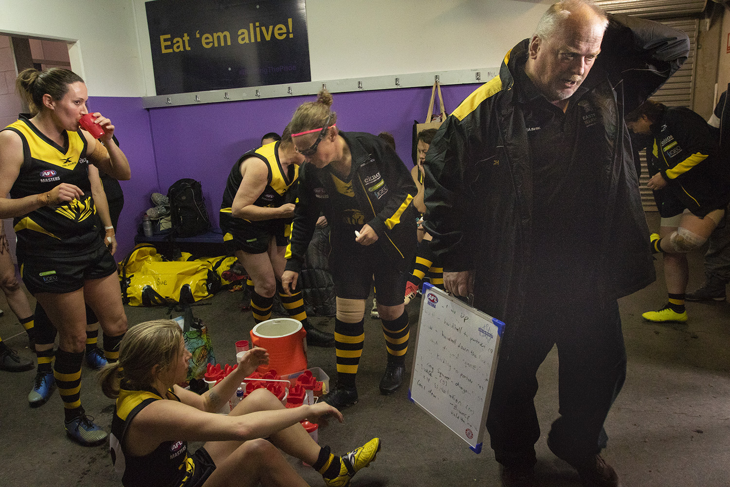 In the rooms at half time the players refresh and steel themselves for a return to action. Hay is a left, refuelling. Coach Peter 'Pants' Nash (right) says the season taught him a lot in terms of technique and management.