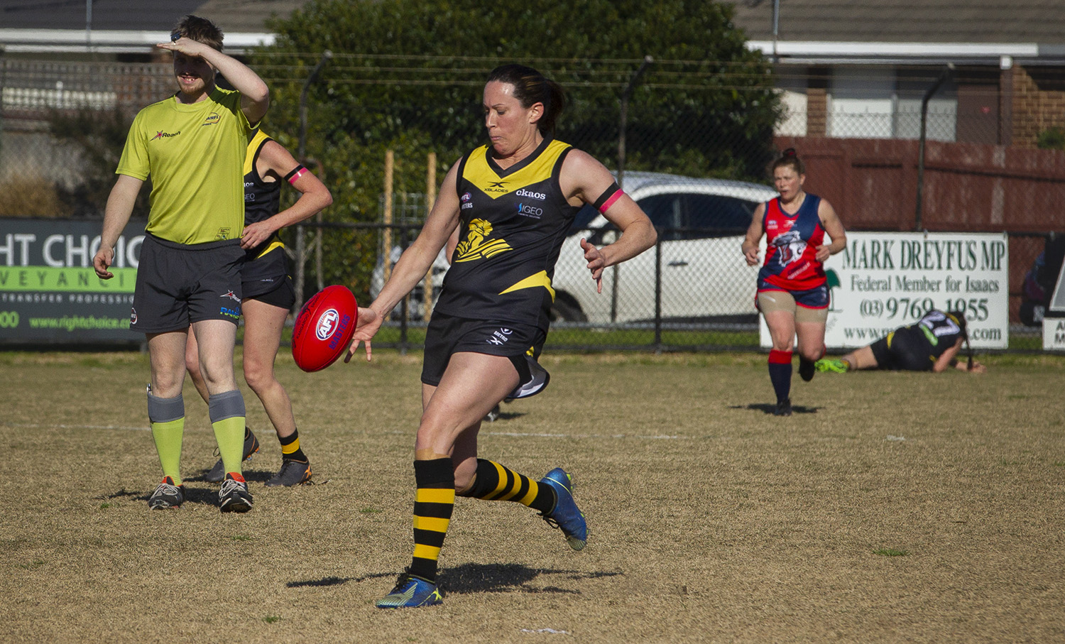 Driving the ball downfield in the final game of the season against rival Coburg.