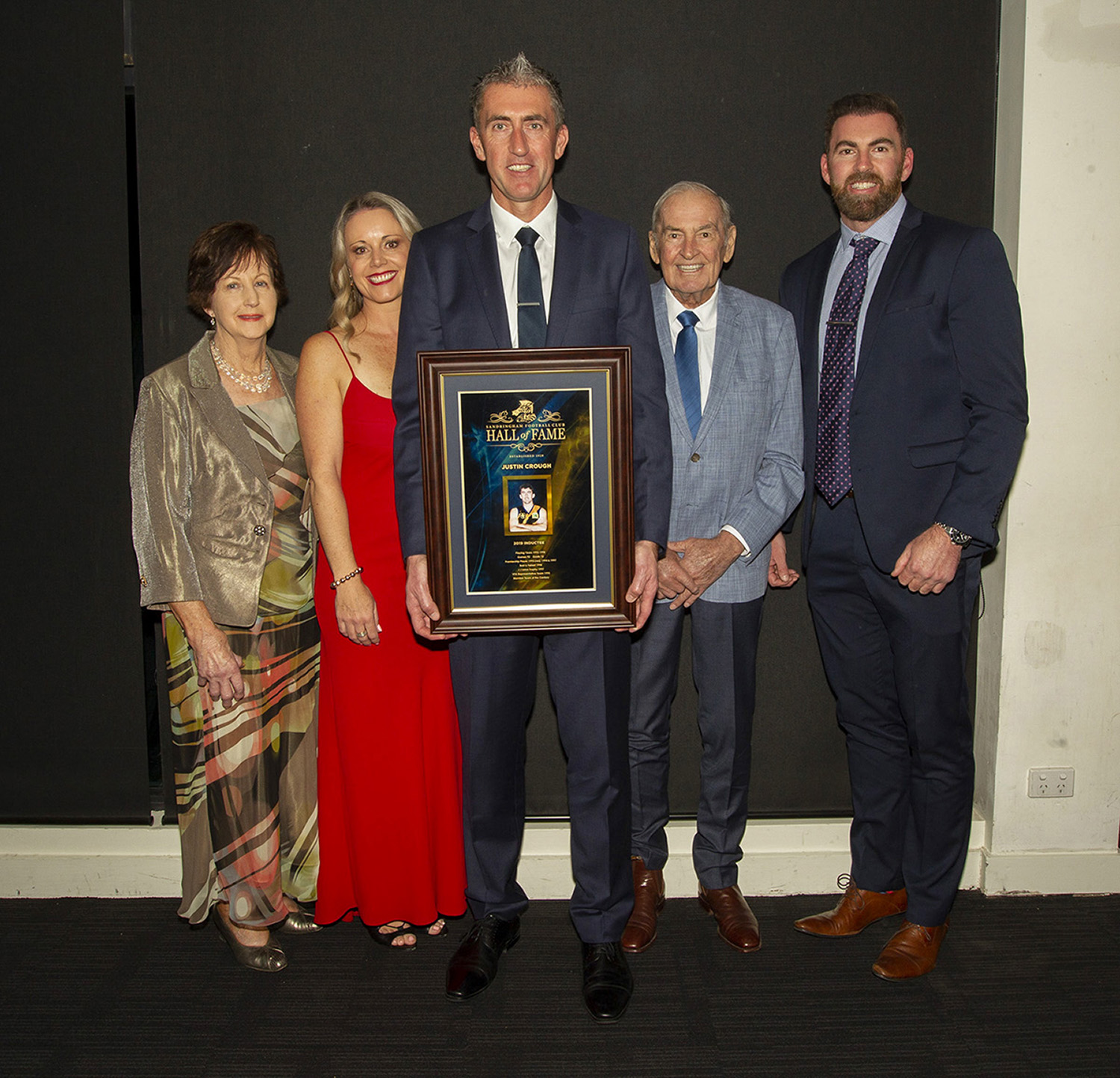 Justin Crough with family members at the 2019 Sandringham Football Club Hall of Fame dinner in June this year. He says there are many others as worthy as him for the honour.