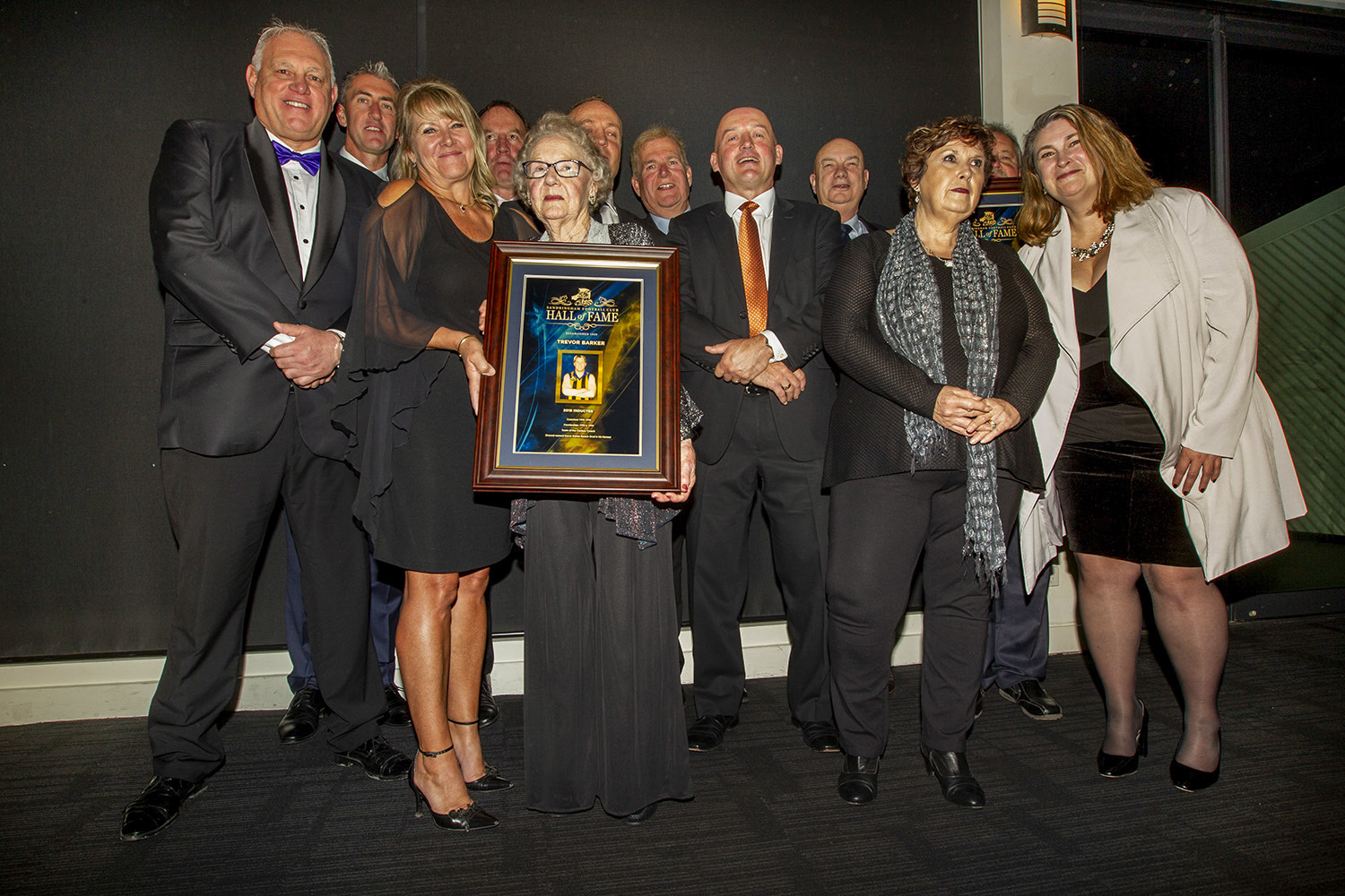 Fellow inductees were part of a gala dinner and social event, where late Sandringham and St.Kilda clubs great Trevor Barker was honoured with the presence of his mother Norma (holding his framed award). Crough is second from left at rear.
