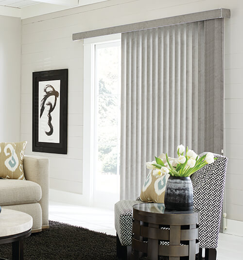 VERTICAL BLINDS  Vertical Blinds can be used in all areas of the home, and are a particularly popular choice for screening sliding glass doors or large windows.  Vertical Blinds are easy to operate. This versatile product can stack to the left, the right, or even be split down the centre. A beaded chain is used to tilt the blades, allowing you to have complete control of privacy and direction of light.  Choose from a number of colours, patterns and designs, then pick your fabric. At Ellis Design Blinds we offer translucent, dimout and blockout fabrics, and can help you to choose which type of material will suit your space the best.