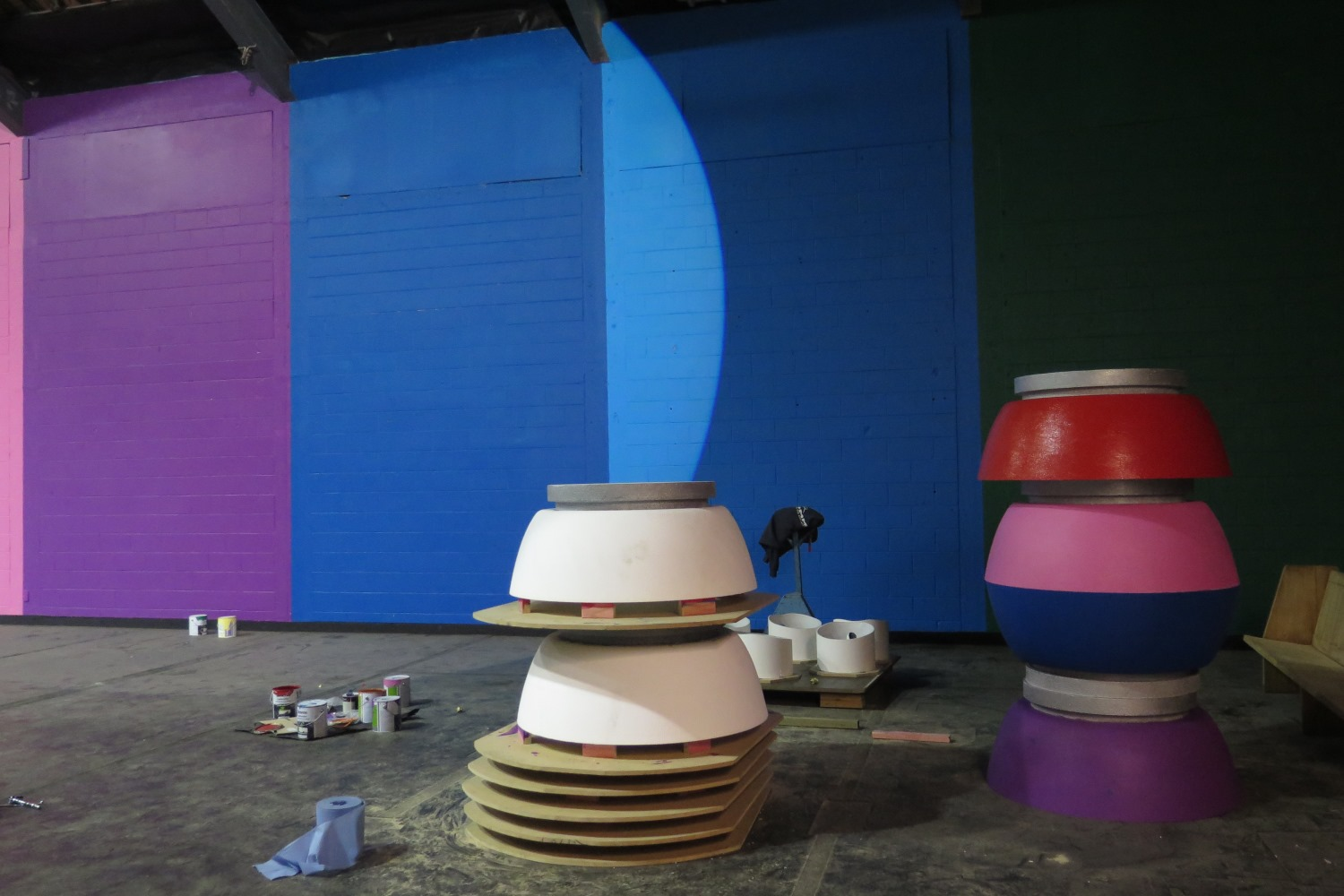 Giant spray can tops being painted, Spectrum 2015 Christchurch