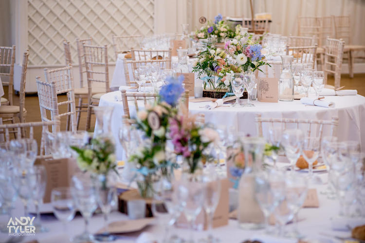 Tables were filled with flowers and tea lights placed on log slices.....