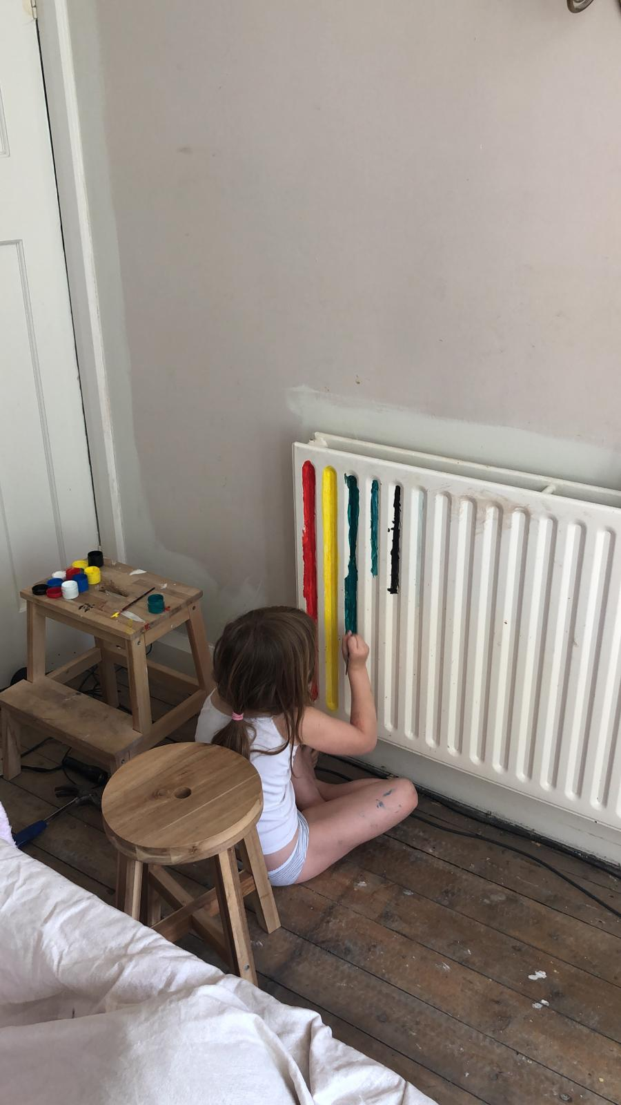 Eva asked one morning while I was obviously half asleep if she could help daddy paint... I said yes and came down to what we're referring to as the Rainbow Radiator.