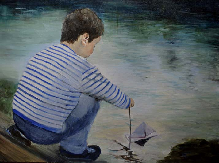 sean-placing-paper-boat-on-water-2-by-mary-mccaffrey.jpg
