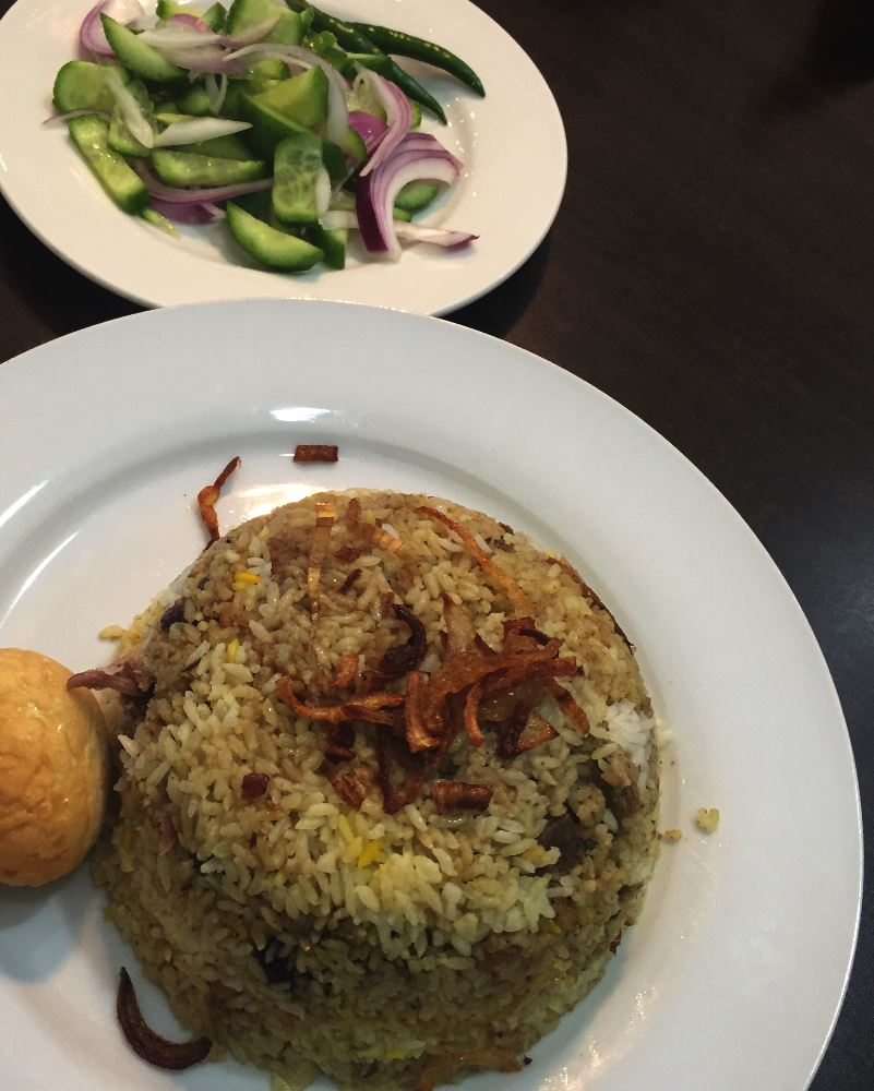 Kacci biryani with marinated goat meat is one of Bottola's specialties.