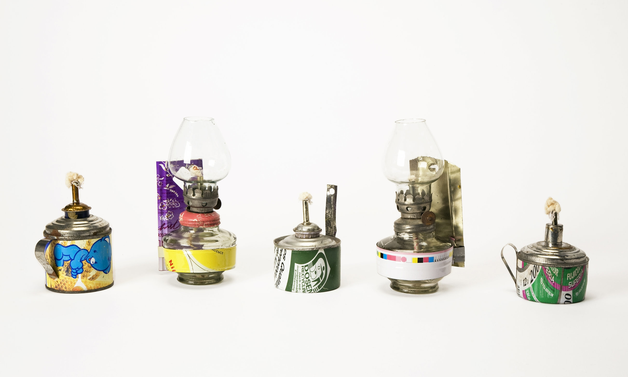 Kerosene lamps made from misprinted tin