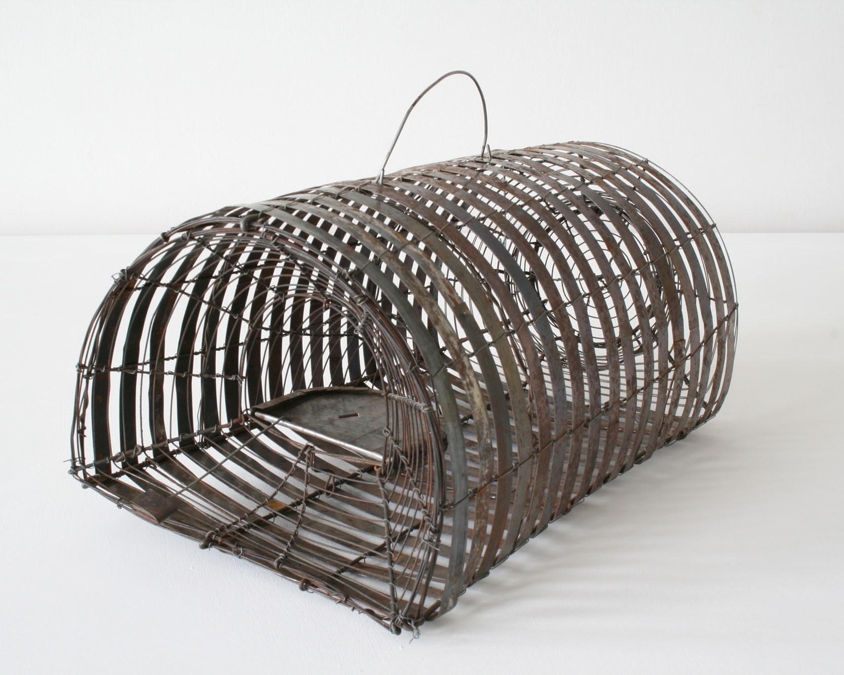 Rat trap made of wire and scrap metal strapping