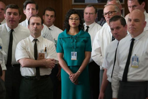 """In this scene from """"Hidden Figures,"""" Taraji P. Henson in her role as Katherine G. Johnson stands out amid her team of fellow mathematicians that helped send astronaut John Glenn into orbit."""
