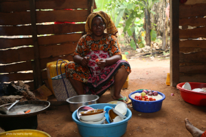 woman in her outdoor kitchen who lives on the spice farm
