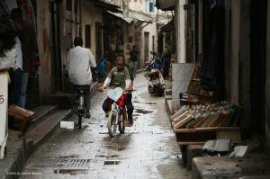 Kids riding their bike through Stone Town