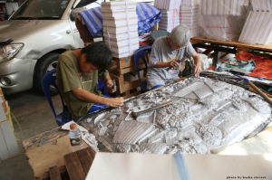 father (right) and son (left) working on a piece together