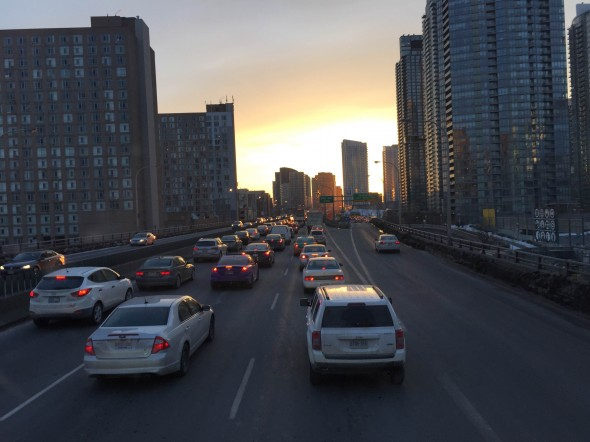 Driving on the Gardiner Expressway, leaving the city. Imagine if all these people took the bus.