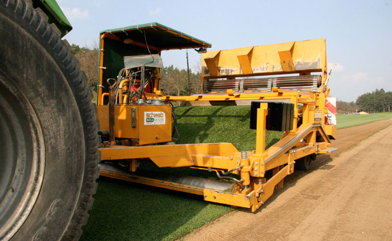 jumbo turf rolls being harvested.