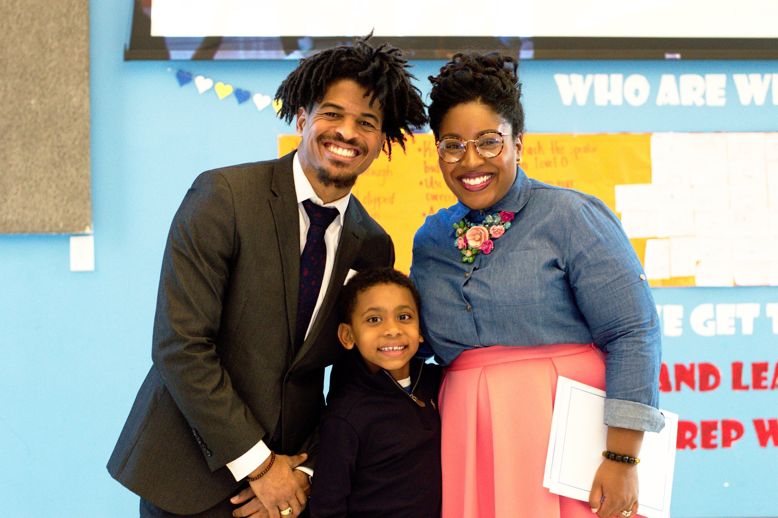 """Mrs. Ashlee"" and Mr. Banks pictured with 1st grade winner Laurent Holland."