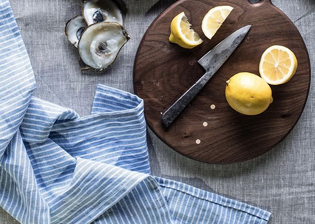 This chilly weather means oyster season is officially upon us.⠀ ⠀ Best of all, these bivalves are one of the most sustainable things you can eat from the ocean. The more you eat them, the more we'll farm, and the more they'll be around to clean the water and prevent coastal erosion. Briney has never tasted so sweet.⠀ ⠀ ⠀ ⠀ Linens @thebayith⠀ Photography @mostly.eats⠀ Wooden board @allisonsamuels  Knife @griffinbladeworks ⠀ ⠀
