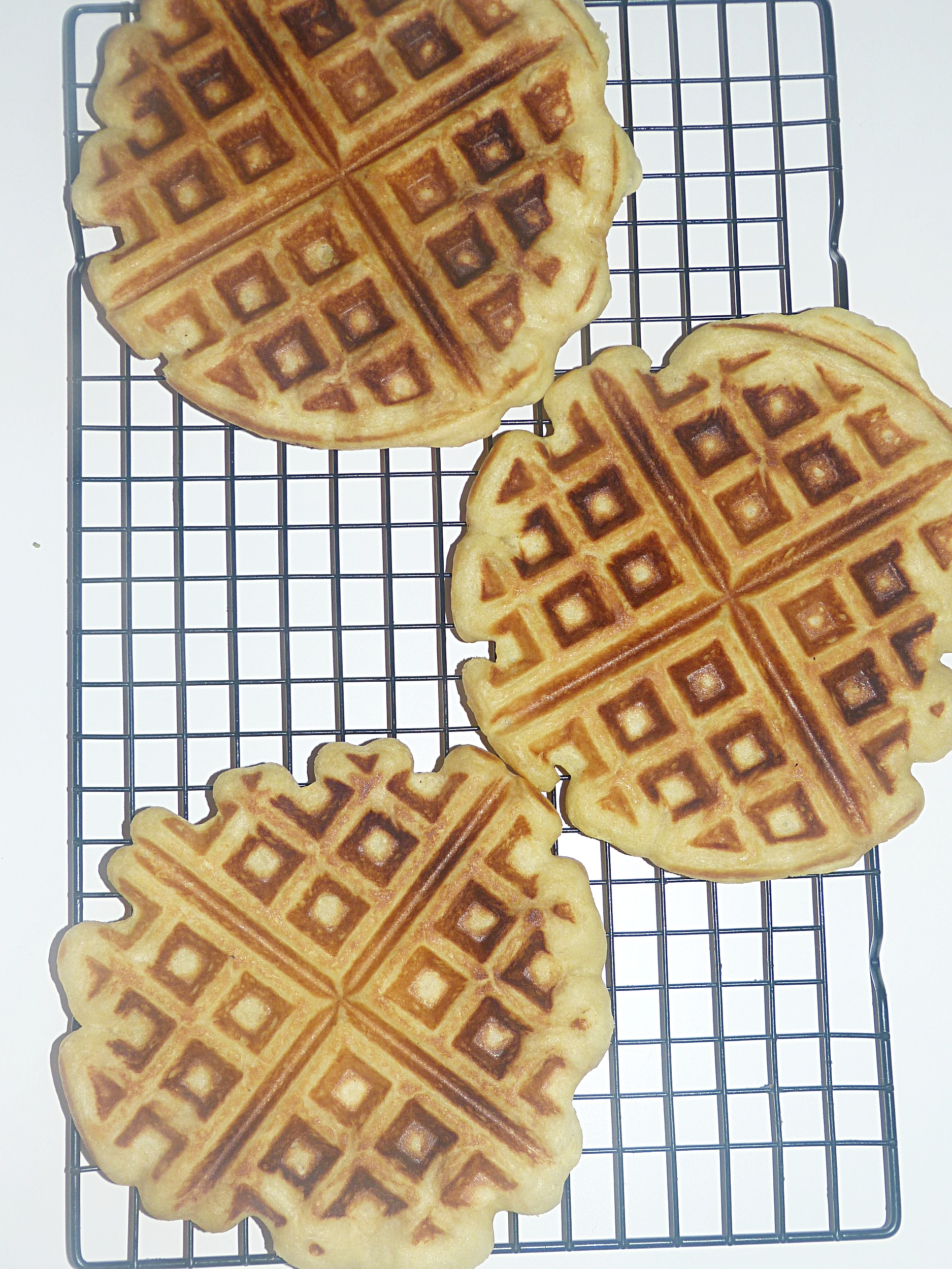 Placing fresh waffles one later deep on a cooling rack while the you cook the rest of the batter, keeps the outsides crispy.