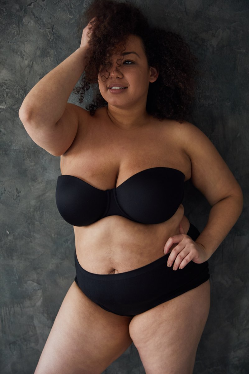 """CRYSTAL - """"I wasn't always plus-size. After my freshman year of college I rapidly gained weight from eating habits and when I went back to my summer job I was asked if I was pregnant. I was taunted for my cheeks growing and not being a size 7 any more. I was depressed and cried many times in dressing room mirrors. As I went on the journey of self love I found modeling. I loved the self expression I developed through this art form. I wanted to pursue it professionally. I was told I'm too fat, too short, not the right fit, everything but you are enough. I pushed forward despite the negativity and I'm now signed. I wear my natural hair to encourage people who struggle to love their crowns."""""""