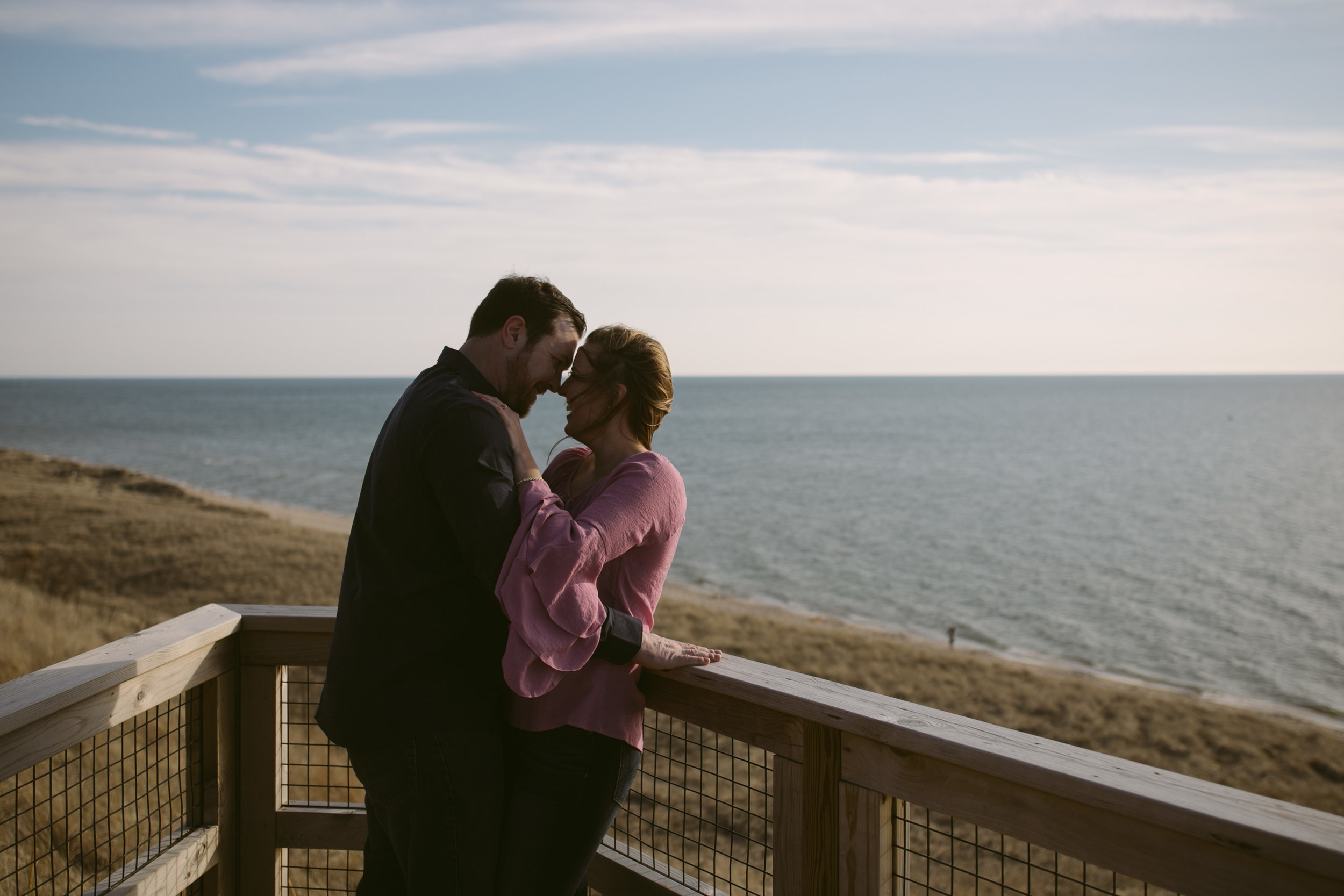 grandrapidsphotographer_hollandmichigan_hollandphotographer_lakemichigan_beachwedding_grandrapids_engaged_jessicadarling_jdarlingphoto_beachengagement019.jpg