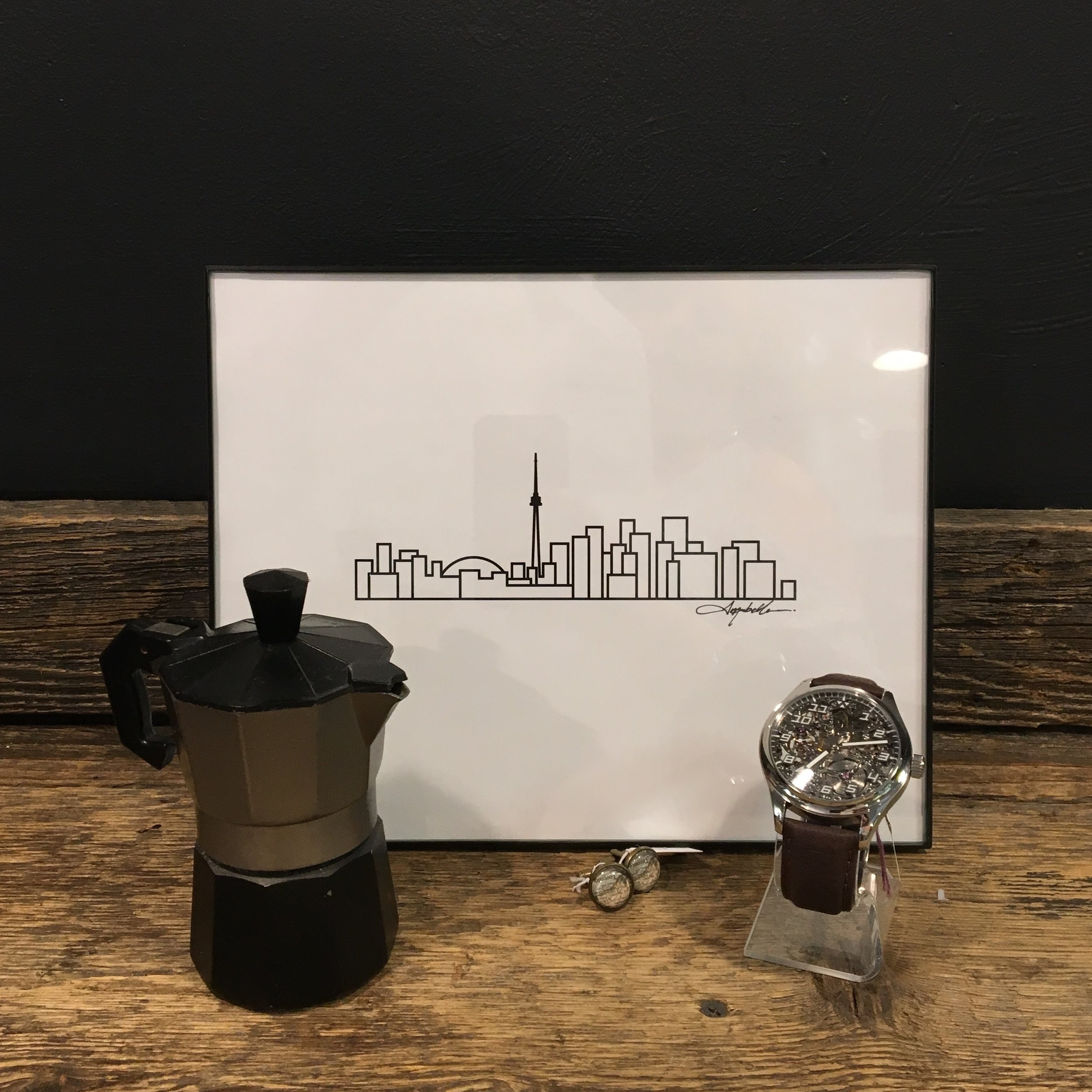 Print by  Ave Mariabell Designs  • Coffeemaker via  Refined Finds  • Cufflinks by  Lisa Young Designs  • Watch by  Wilk Watchworks