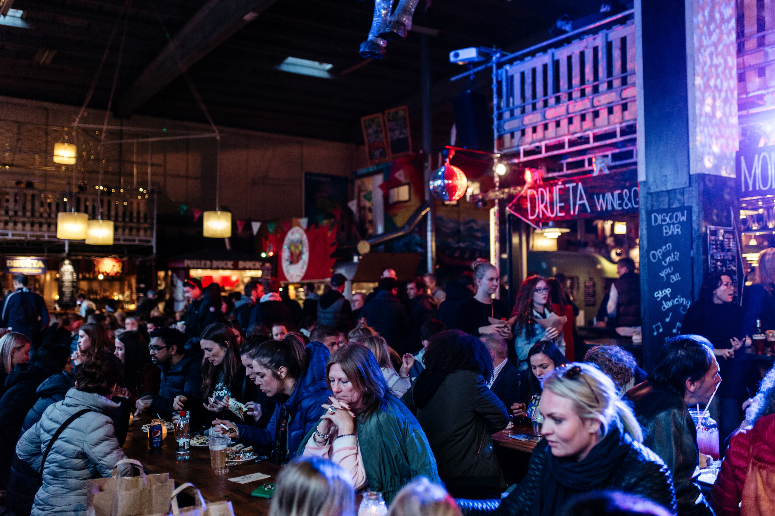 A bit grungy, yet an exceptionally lively atmosphere on Papirøen as crowds of people find space to eat!
