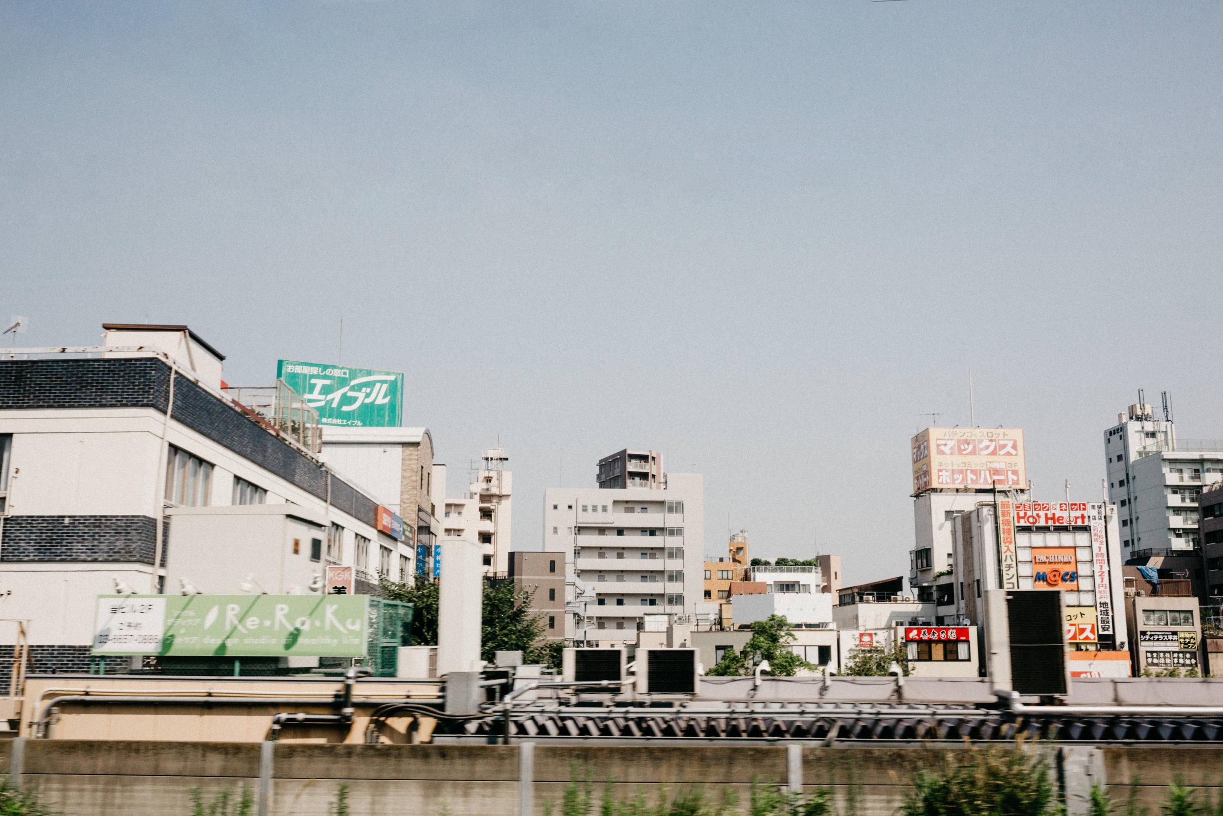 View from Narita Express rail entering Tokyo
