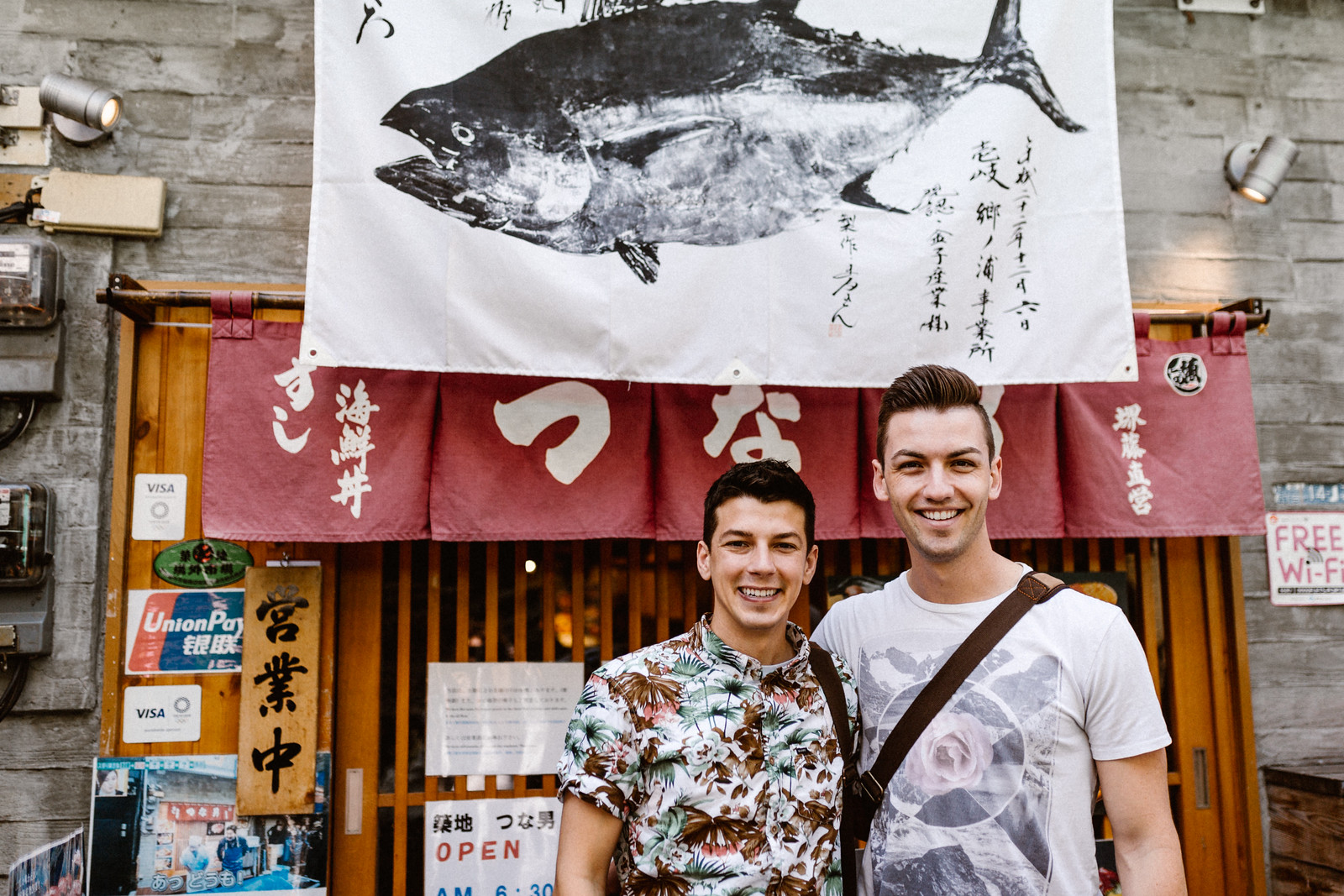 Matthew and Michael gay husbands in front of sushi restaurant tsukiki market Tokyo Japan