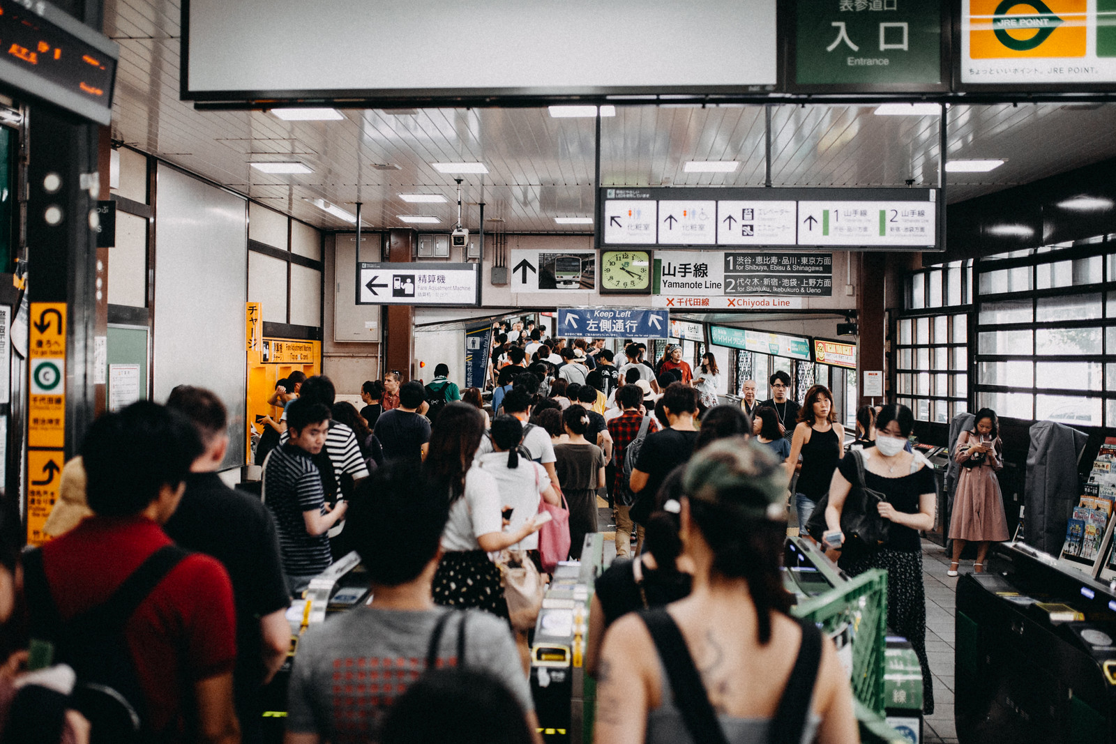 Inside a crowded subway station near Harajuku and Yoyogi Park in Tokyo Japan full of people