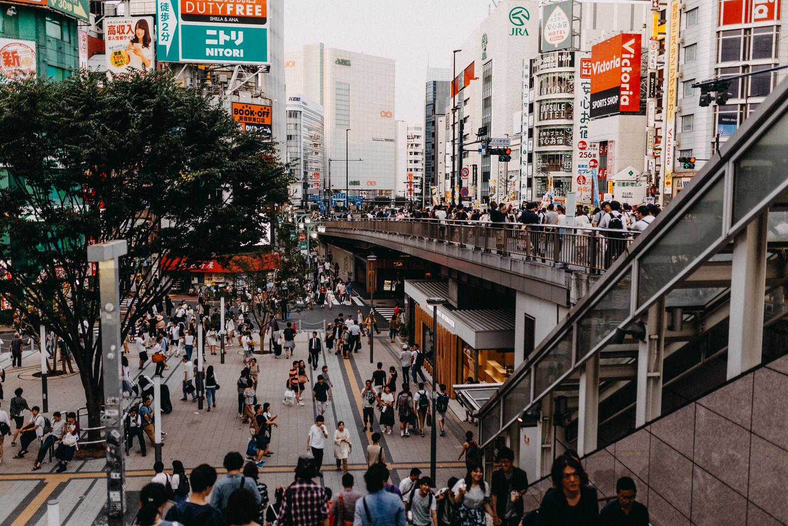Crowded streets near Shinjuku Ku Central Station in Tokyo Japan
