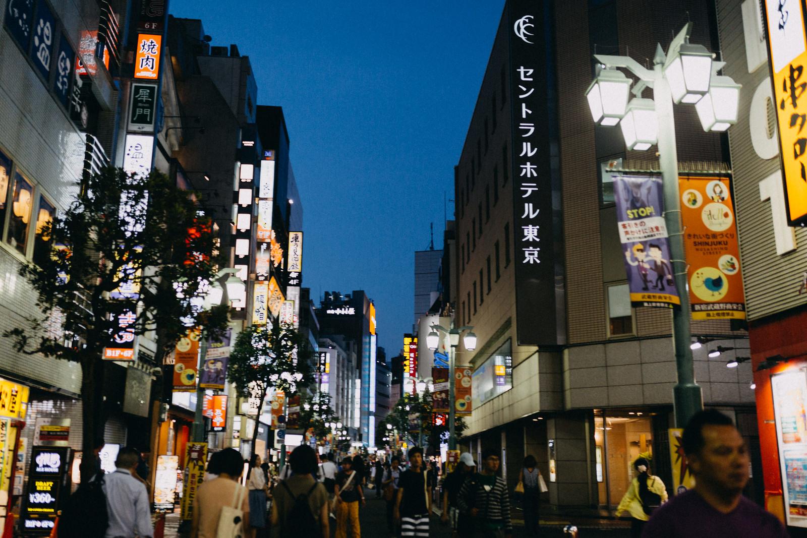 Lots of people in crowded shinjuku street experiencing night life