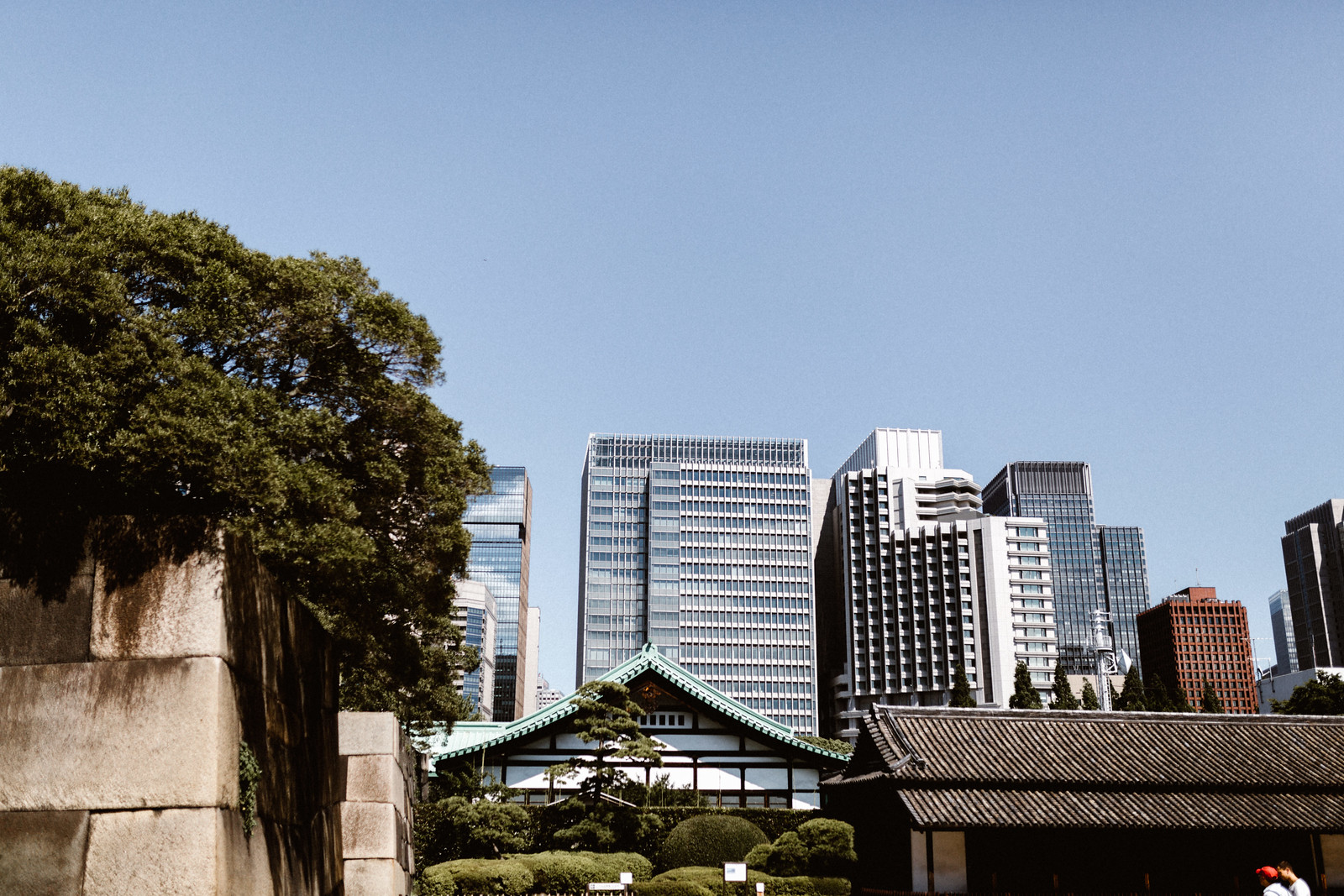 The beautiful architecture of the imperial palace juxtaposed to the high rises of central Ginza. The action of Tsukiji market is just a short walk away from this monumental and historic yet peaceful landmark.
