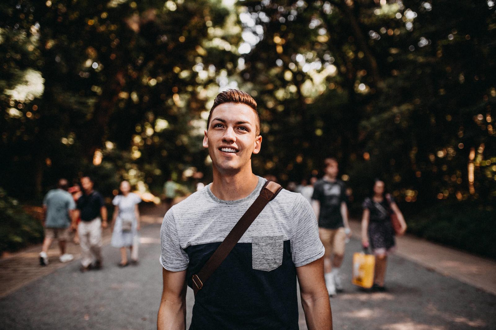 a tourist walking in Yoyogi Park to Meiji Jingu Shrine gay backpacker