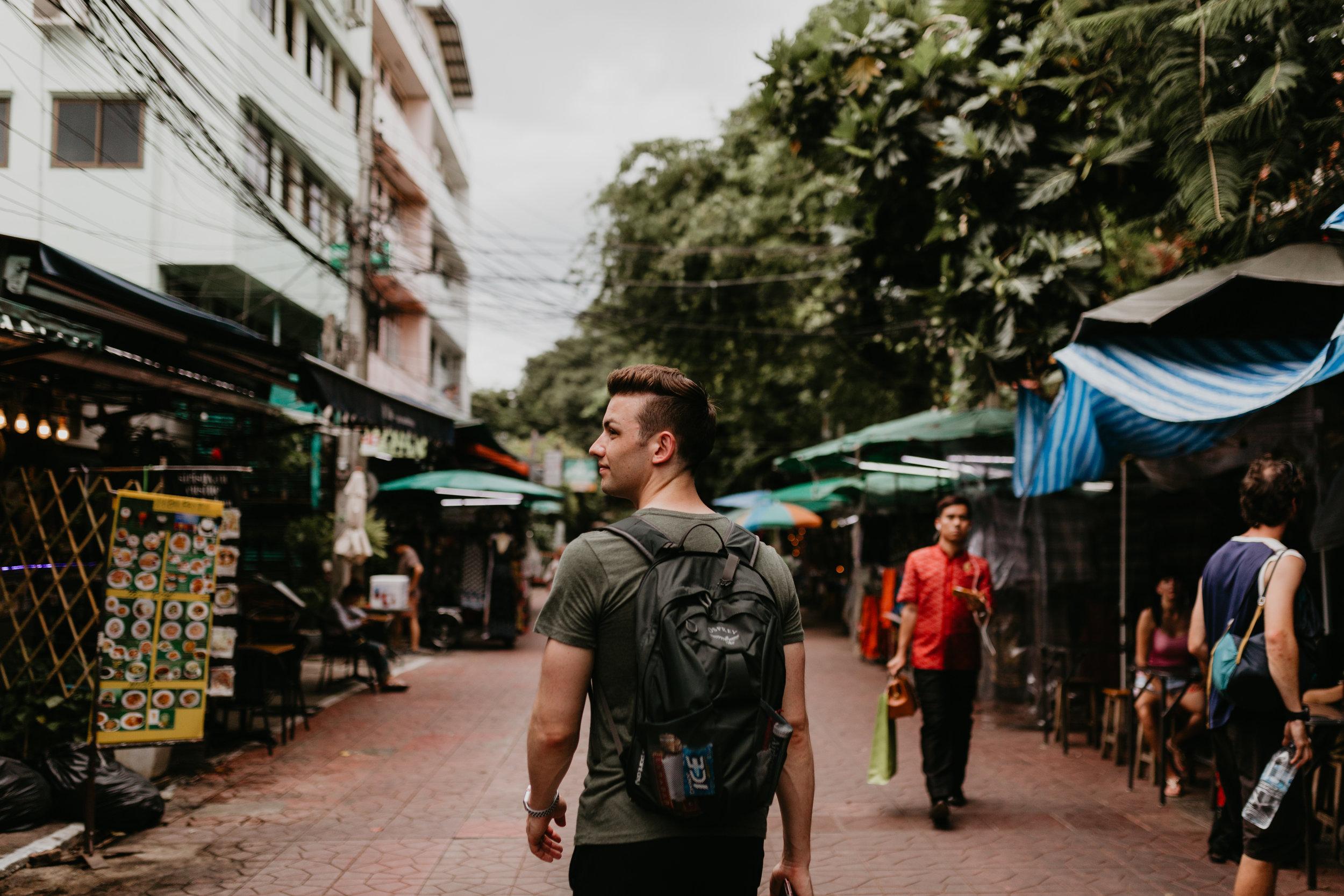 Man backpacking Khao San Road.jpg