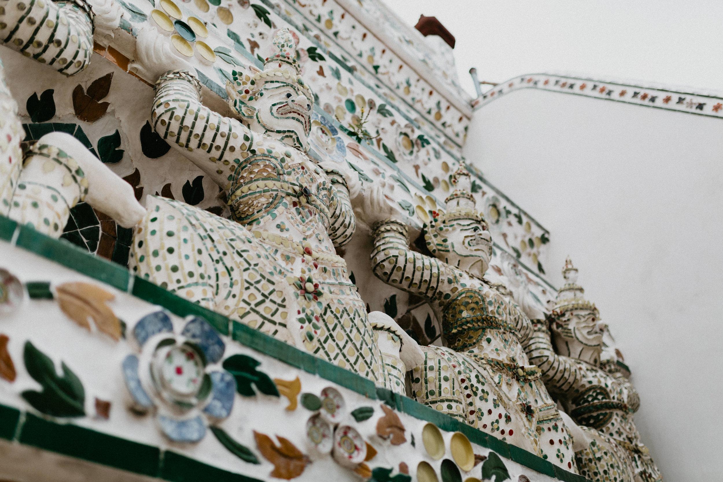 Carvings and art at Wat Arun.jpg
