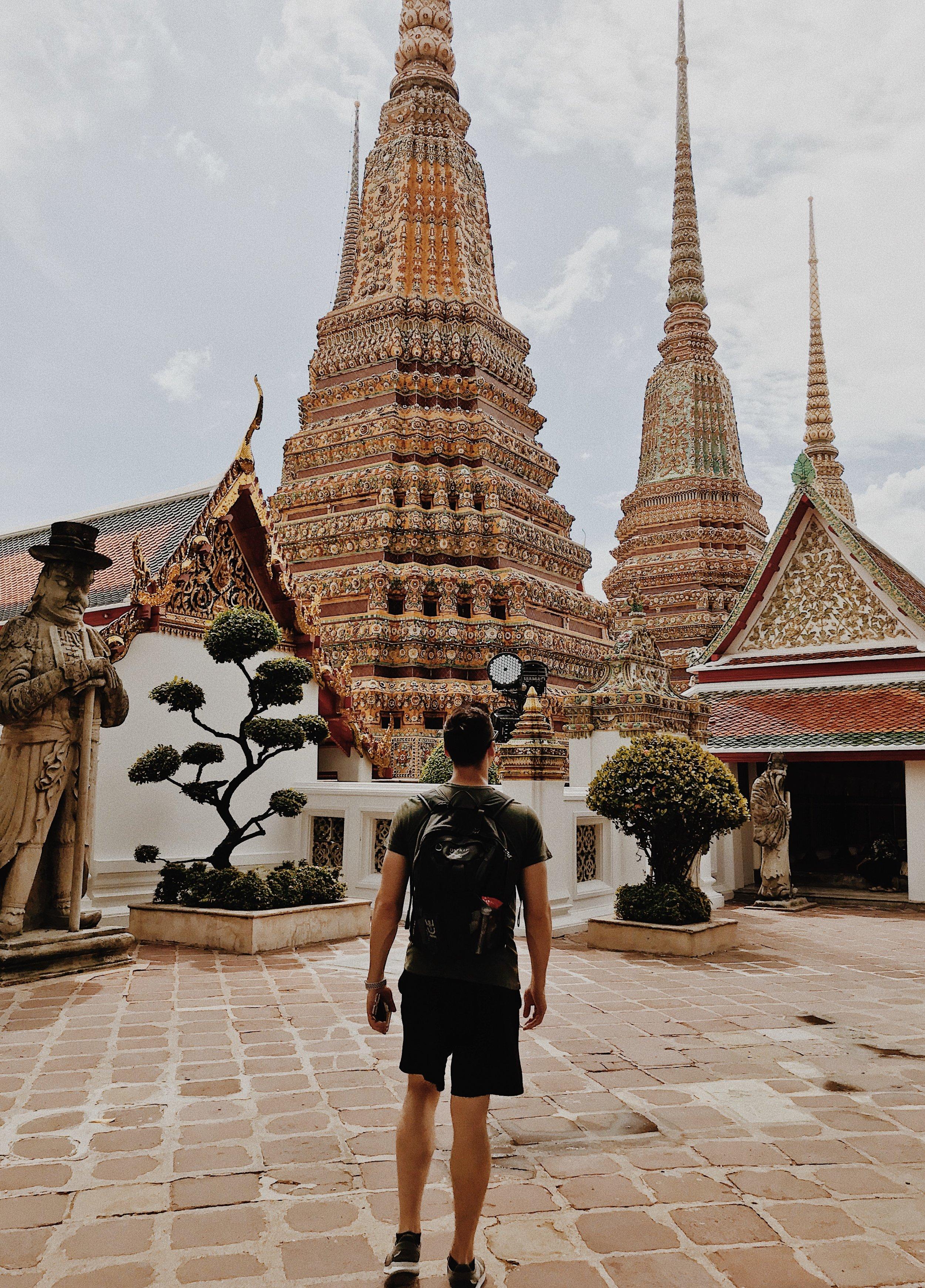 Man standing outside of Wat Pho.JPG