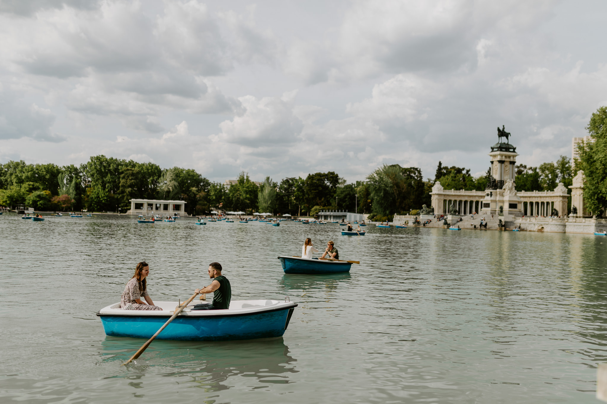 Bask in the sun and row boats for a while in El Retiro Park's man-made lake!