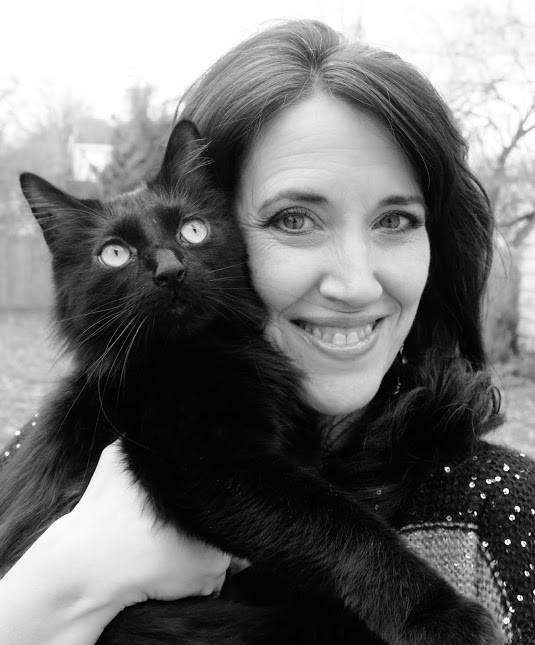 kely st claire, woman with black cat