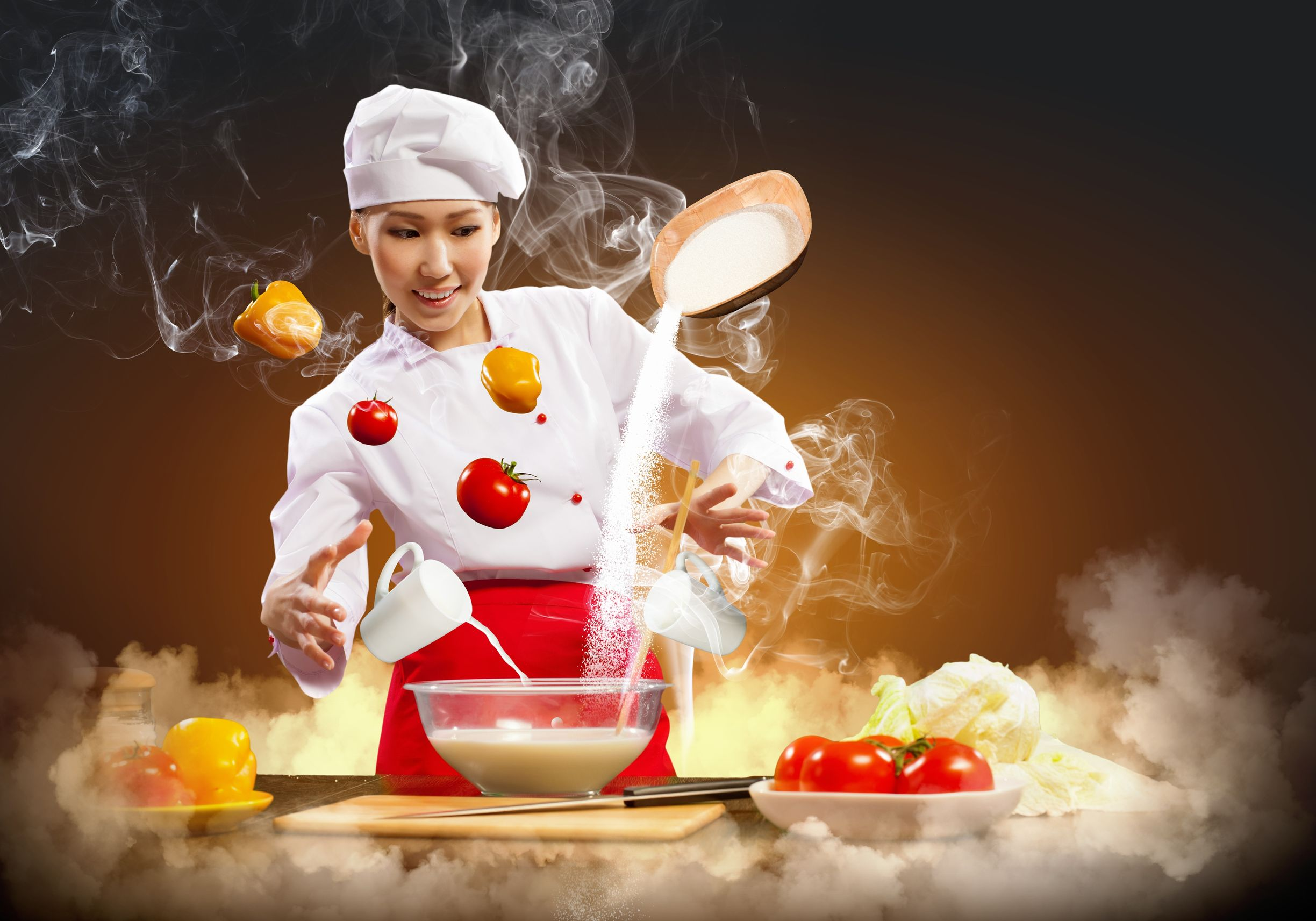 17428547 - asian female cooking with magic against color background