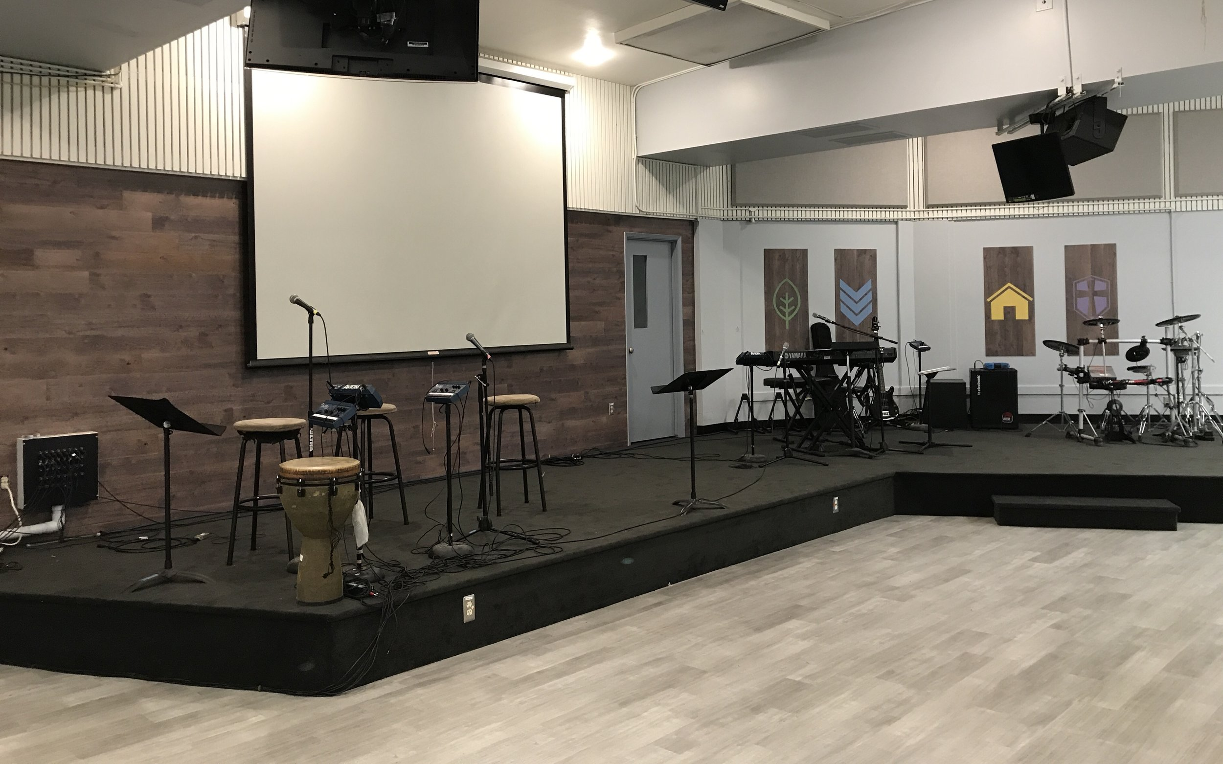 Providing Forerunner Christian Church a modern design - Forerunner, a Chinese Christian Church contacted us about remodeling their multi-purpose room with a goal of a more modern look. This area is used for many different events such as meals, youth group services, vacation bible school, etc. It also serves as their welcome center.We supplied and installed Karndean vinyl plank flooring, wood Wallplanks and charcoal walk off tiles in multiple areas throughout their multi purpose room and classrooms.Location: Fremont, CA