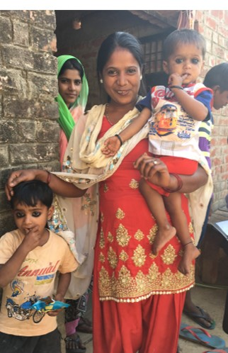 Muni Yadav holds kids.jpg