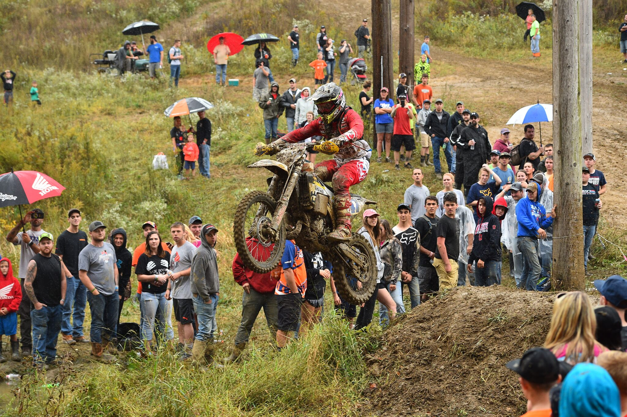 Hunter Neuwirth takes on the infamous creek jump at the Powerline Park GNCC. - Photo - Ken Hill