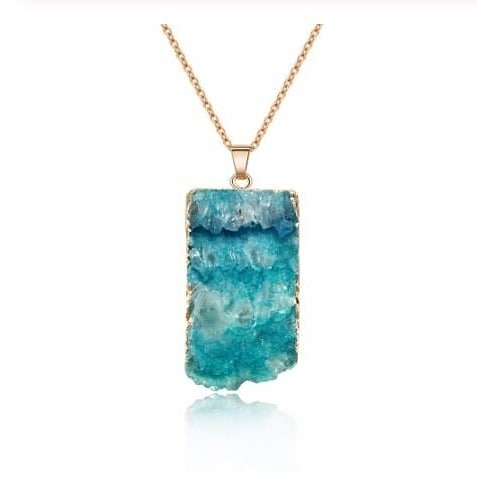 Our Caribbean Blue Pendant necklace sells out EVERY time we take it to a market, because it is stunning in person. Real druzy stone, framed in gold plate, the colors are layered so beautifully. The pendant measures just over 3 centimeters, and the delicate gold chain measures 18 inches.